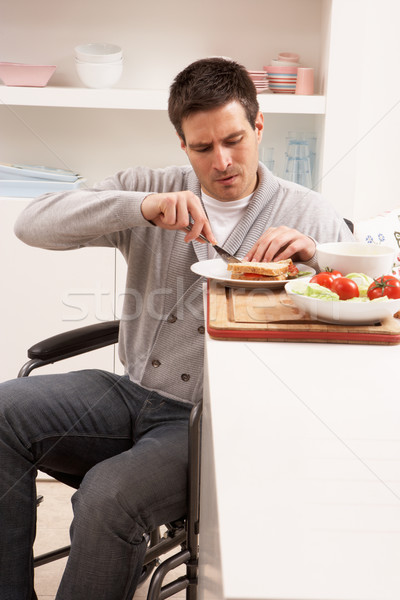 Disabled Man Making Sandwich In Kitchen Stock photo © monkey_business