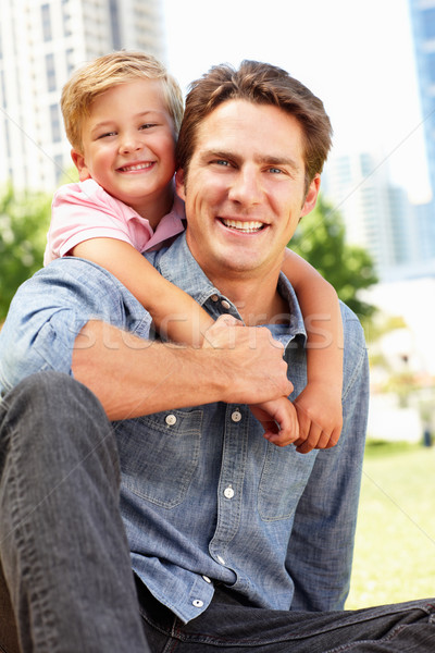 Man sitting in city park with young son Stock photo © monkey_business