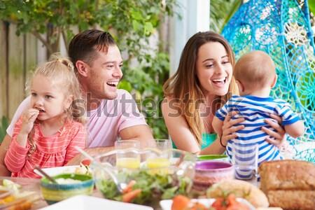 Familia vacaciones comer aire libre mujer casa Foto stock © monkey_business