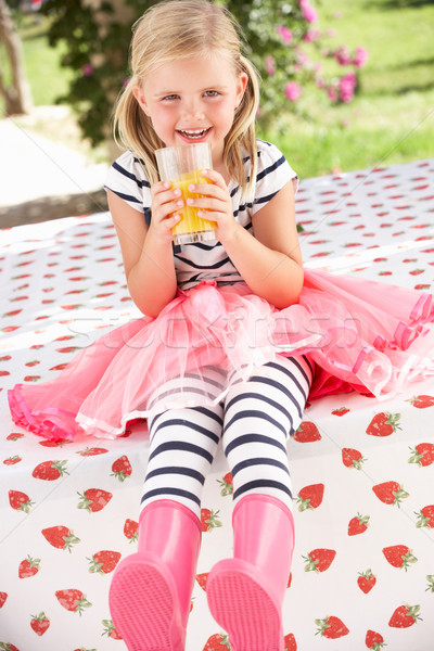 Young Girl Wearing Pink Wellington Boots Drinking Orange Juice Stock photo © monkey_business