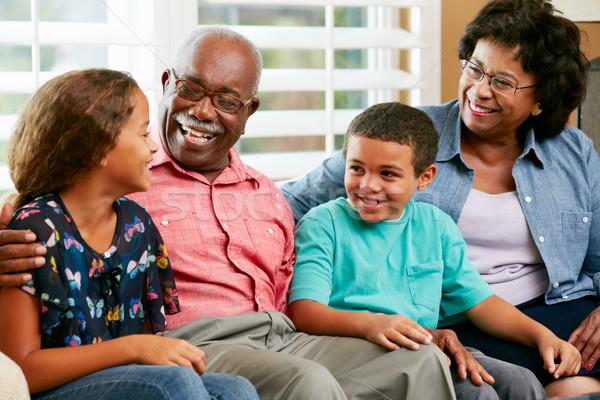 Nagyszülők unokák ül kanapé beszél nő Stock fotó © monkey_business