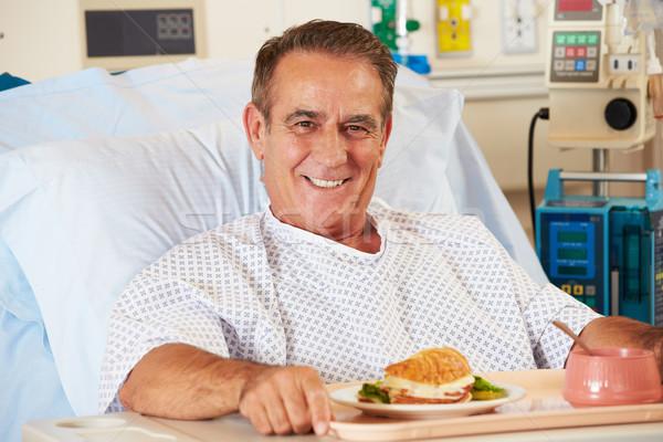 мужчины пациент еды человека Сток-фото © monkey_business