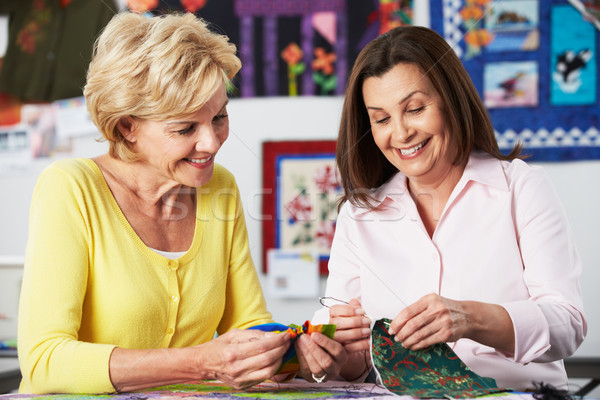 Two Women Sewing Quilt Together Stock photo © monkey_business