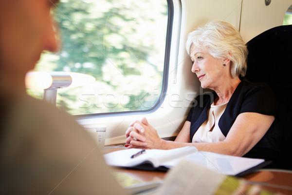 üzletasszony megnyugtató vonat utazás nők technológia Stock fotó © monkey_business