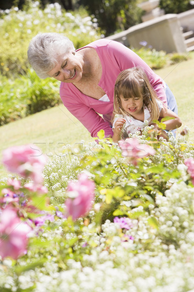 Grandmother and granddaughter outdoors in garden smiling Stock photo © monkey_business