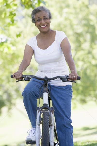 Senior woman on cycle ride Stock photo © monkey_business