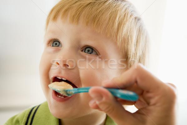 Anya etetés fiatal srác bébiétel kéz gyerekek Stock fotó © monkey_business