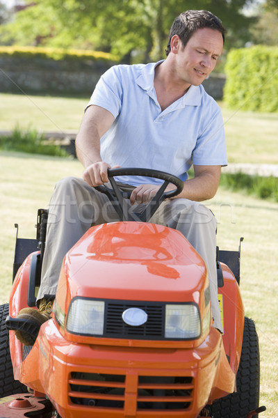 Man outdoors driving lawnmower Stock photo © monkey_business