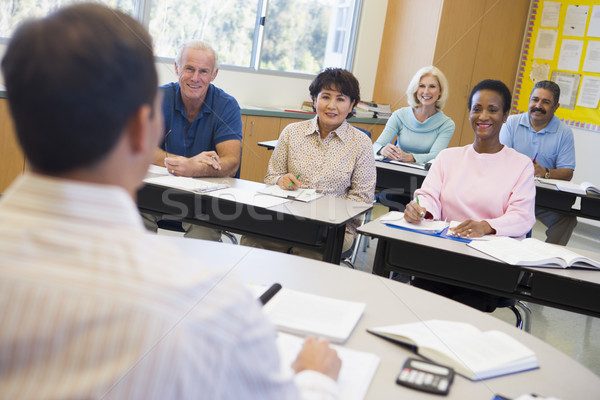 Mature students and their teacher in a classroom Stock photo © monkey_business