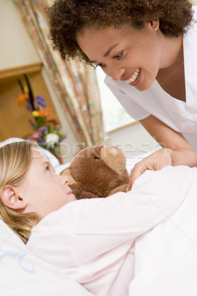 Nurse Checking Up On Young Girl In Hospital Stock photo © monkey_business