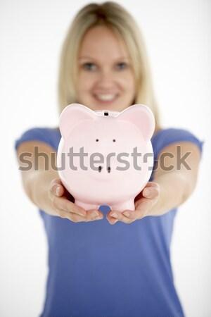 Woman Holding Piggy Bank Stock photo © monkey_business