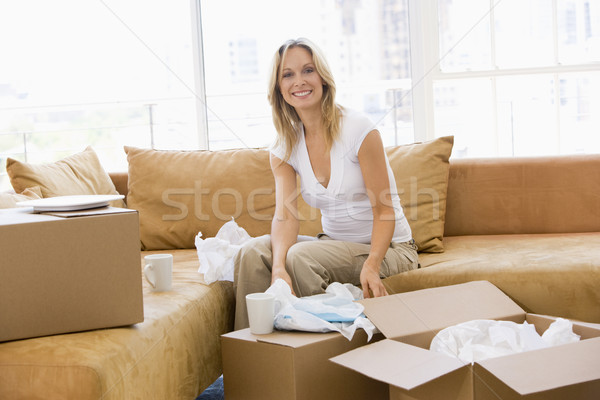 Femme cases nouvelle maison femme souriante souriant maison Photo stock © monkey_business