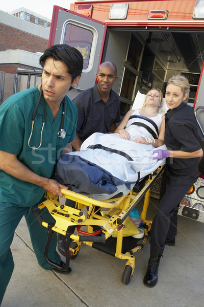 Paramedics and doctor unloading patient from ambulance Stock photo © monkey_business