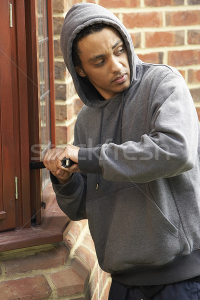 Genç ev adam genç erkek hırsız Stok fotoğraf © monkey_business