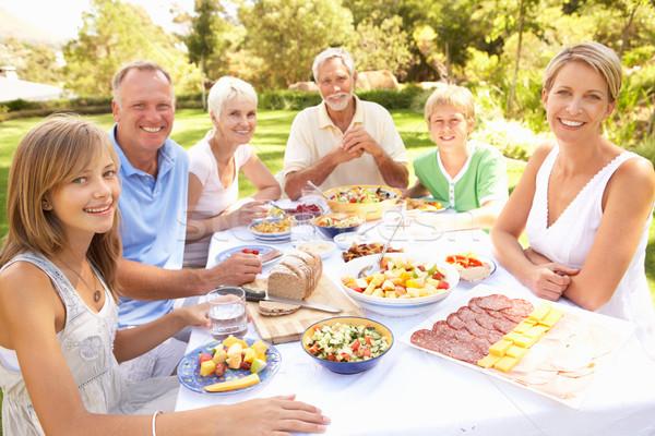 Stock photo: Extended Family Enjoying Meal In Garden