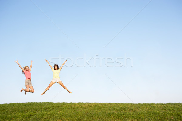 Young women jumping in air Stock photo © monkey_business
