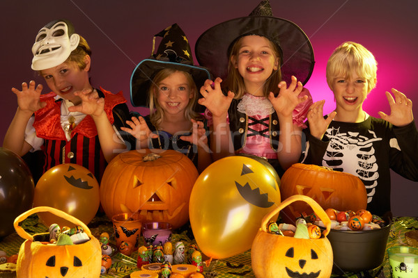 Halloween party with children wearing fancy costumes Stock photo © monkey_business