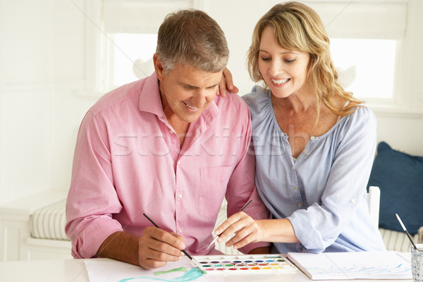 Mid age couple painting with watercolors Stock photo © monkey_business