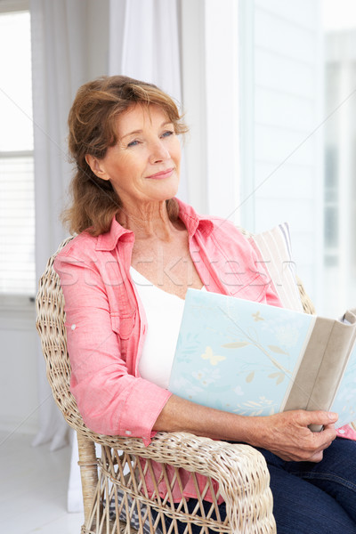 Senior woman with photo album Stock photo © monkey_business