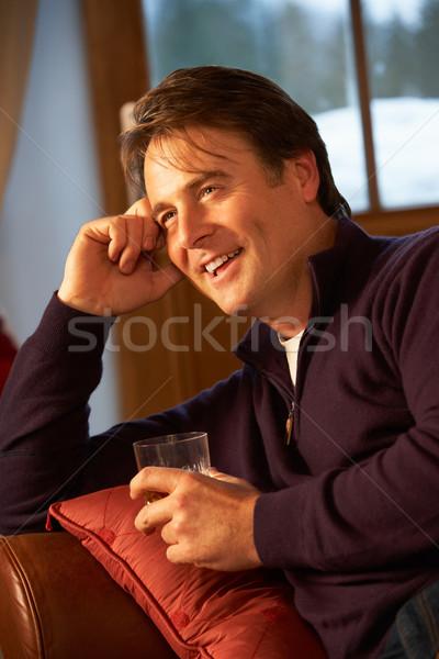 Középkorú férfi megnyugtató ül kanapé iszik whisky Stock fotó © monkey_business