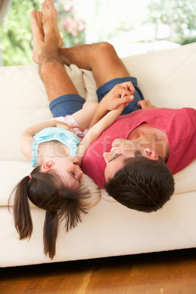 Father Lying Upside Down On Sofa With Daughter Stock photo © monkey_business