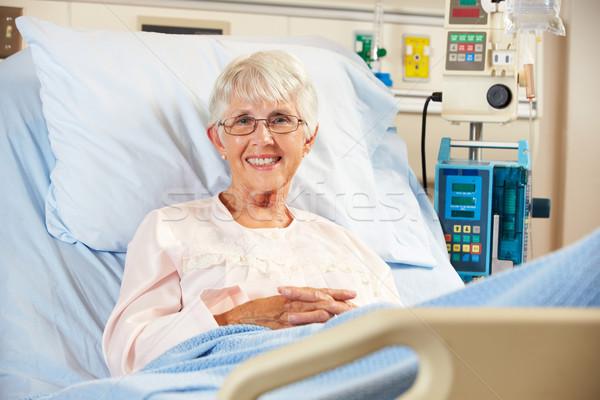 Portré idős női beteg megnyugtató kórházi ágy Stock fotó © monkey_business