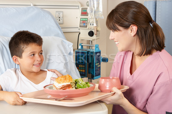 Nurse Serving Child Patient Meal In Hospital Bed Stock photo © monkey_business