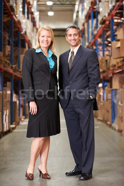 Kobieta interesu biznesmen dystrybucja magazynu człowiek kobiet Zdjęcia stock © monkey_business