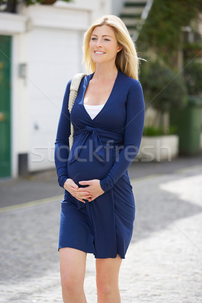 Pregnant Woman Walking Along Urban Sidewalk Stock photo © monkey_business