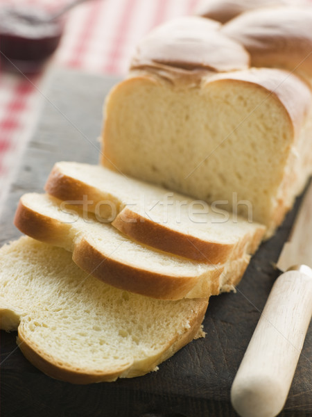 Brioche Loaf Sliced on a Chopping Board Stock photo © monkey_business