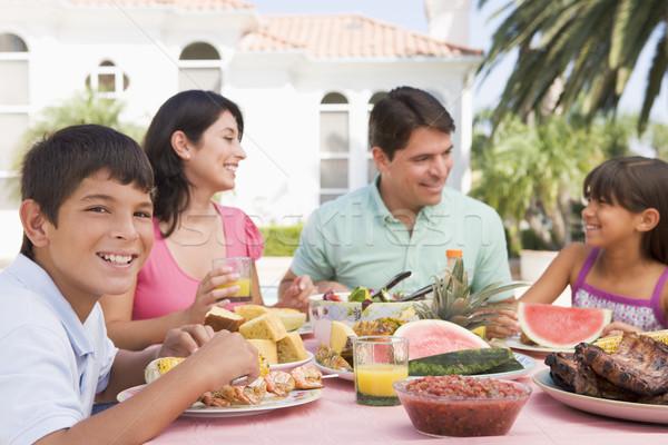 Stockfoto: Familie · genieten · barbecue · vrouw · huis · voedsel