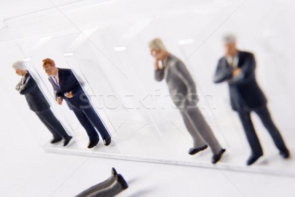 Rij zakenman een uit lijn model Stockfoto © monkey_business