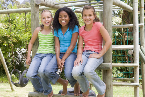 Three young girl friends at a playground smiling Stock photo © monkey_business