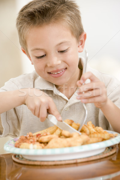 Manger poissons puces souriant Photo stock © monkey_business