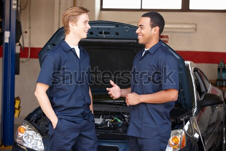 Two paramedics cheerfully removing empty gurney from ambulance Stock photo © monkey_business