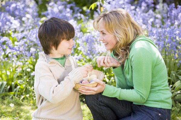 Stock photo: Mother and son on Easter looking for eggs outdoors smiling