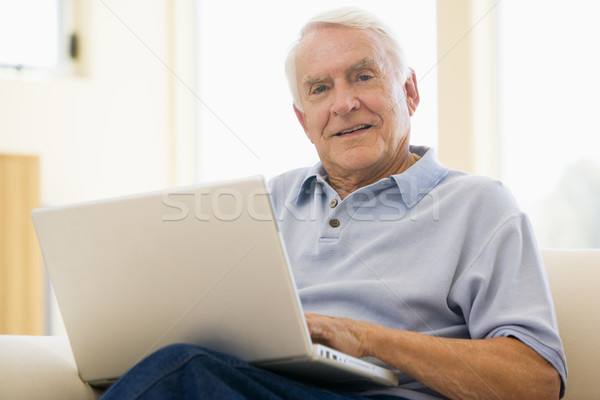 senior,man,laptop,computer,at home,sofa,browsing,surfing,interne Stock photo © monkey_business