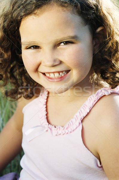 Jovem sessão ao ar livre sorridente menina sorrir Foto stock © monkey_business