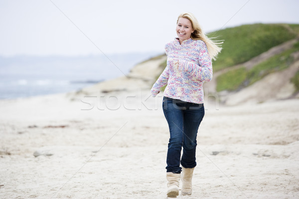 Woman running at beach smiling Stock photo © monkey_business