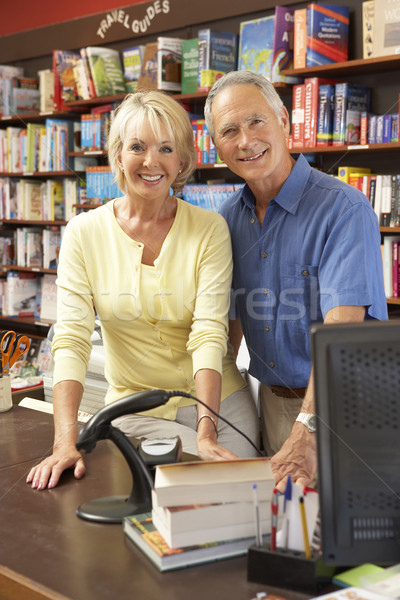 Couple courir librairie femme livre magasin Photo stock © monkey_business