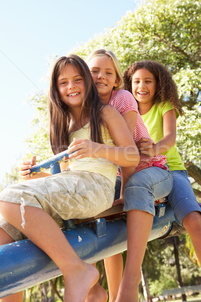 Three Girls Riding On See Saw In Playground Stock photo © monkey_business