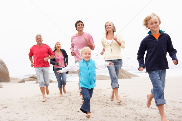Three Generation Family Running Along Winter Beach Together Stock photo © monkey_business