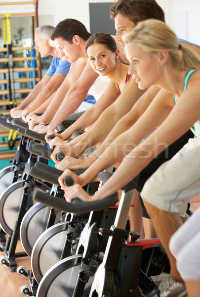 Woman Cycling In Spinning Class In Gym Stock photo © monkey_business