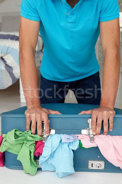 Tizenéves fiú küszködik zárt bőrönd portré tini Stock fotó © monkey_business