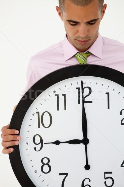 Jeunes affaires géant horloge mains travaux Photo stock © monkey_business