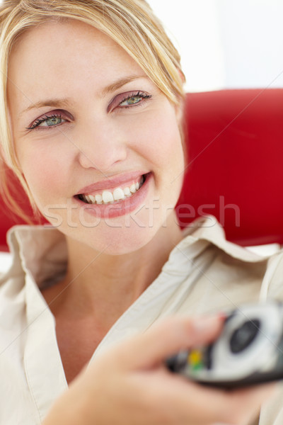 Kadın uzaktan kumanda televizyon gözler sandalye portre Stok fotoğraf © monkey_business