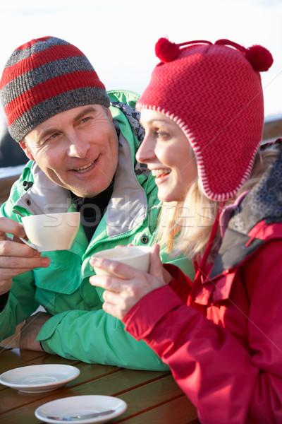 Couple boisson chaude homme heureux neige Photo stock © monkey_business