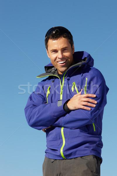 Férfi áll hó visel meleg ruházat Stock fotó © monkey_business