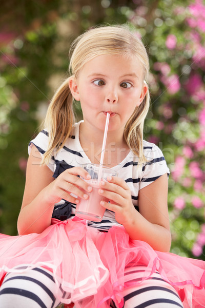 Young Girl Wearing Pink Wellington Boots Drinking Milkshake Stock photo © monkey_business