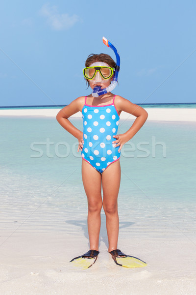 Girl Standing On Beach Wearing Snorkel And Flippers Stock photo © monkey_business